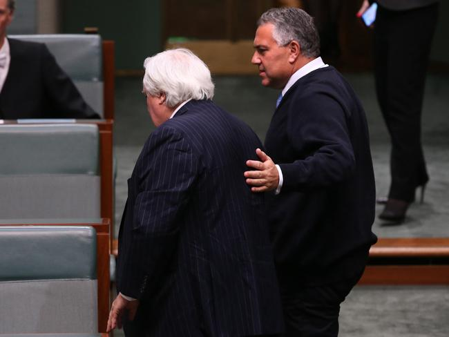 Together at last: Clive Palmer and Treasurer Joe Hockey in the House of Representatives yesterday. Photo: Kym Smith.