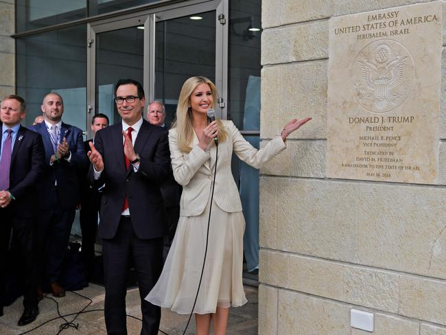 U Treasury Secretary Steve Munchinclaps as Ivanka Trump unveils an inauguration plaque during the opening of the US embassy in Jerusalem. Picture: AFP