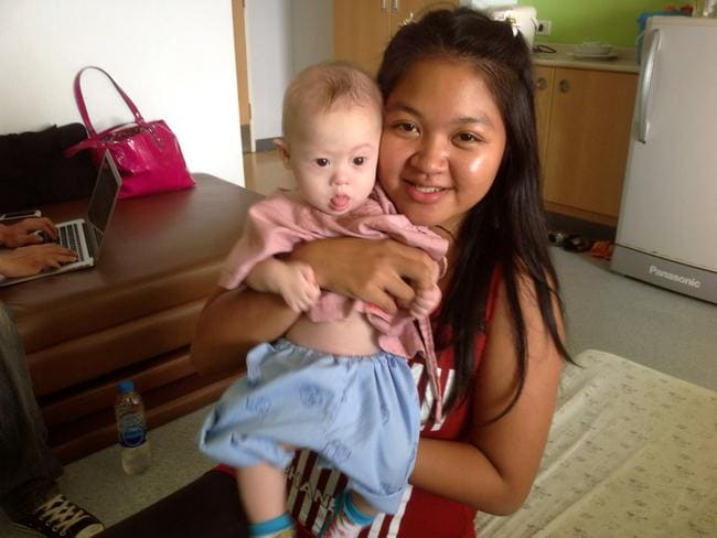Abandoned ... Thai surrogate mother Pattaramon Chanbua poses with baby Gammy.