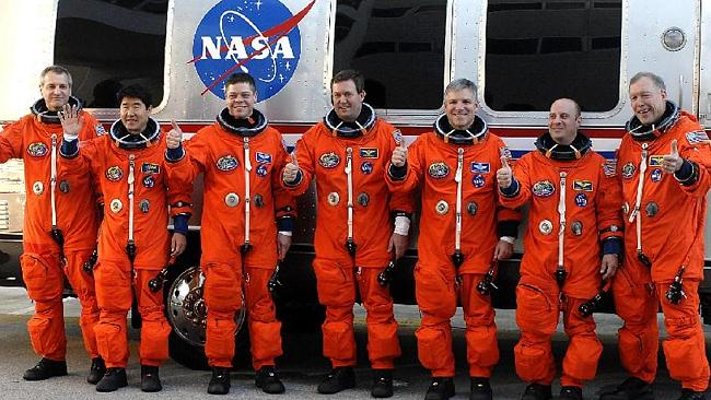 Garrett Reisman (second from the right) with the US space shuttle Endeavour crew. AFP Photo/Bruce Weaver