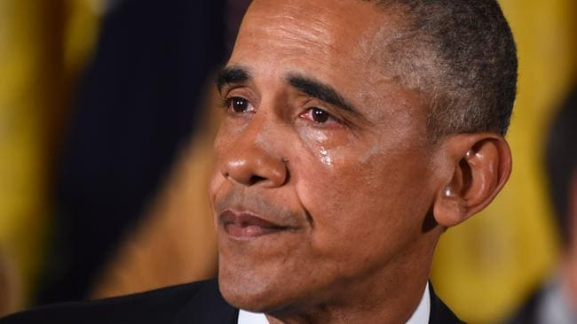 Barack Obama gets emotional as he delivers his statement about gun control. Picture: AFP PHOTO/JIM WATSON