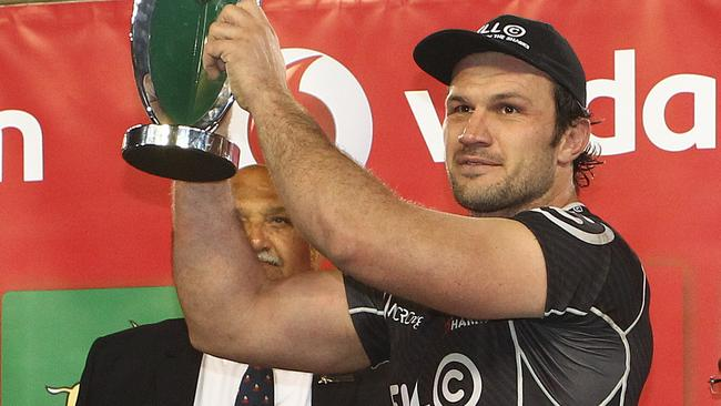 Sharks captain Bismarck du Plessis raises the South African Conference Trophy during the Super Rugby match between DHL Stormers and Cell C Sharks.