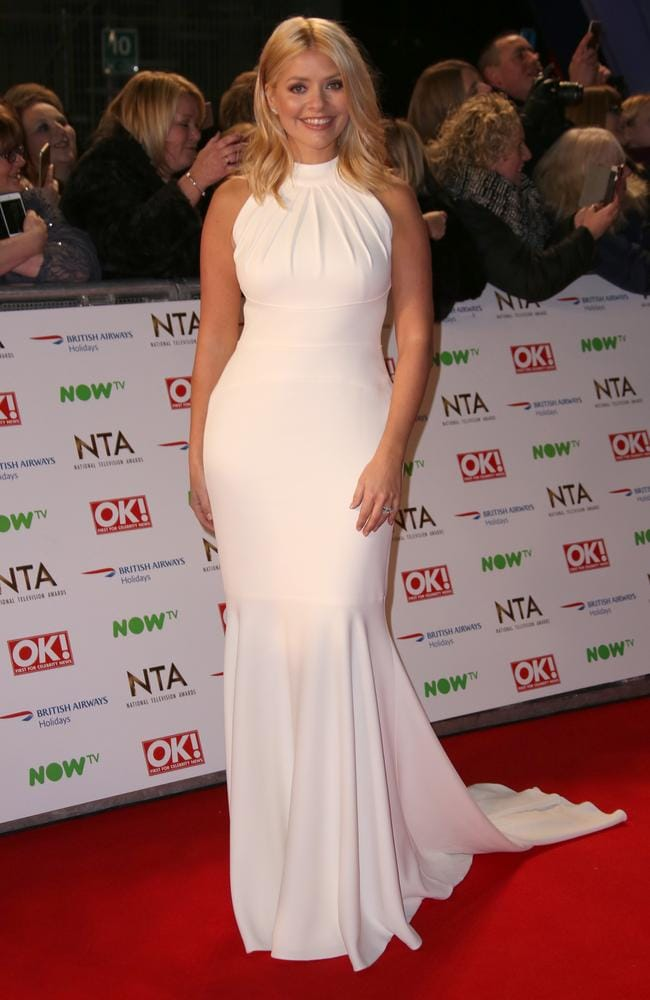 Calm before the storm: A stain-free Holly arrives at the National Television Awards the night before. Picture: AP