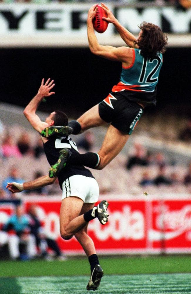 Matthew Richardson takes a hanger over Nigel Lappin playing for the Allies.
