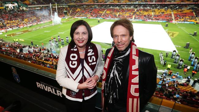 Queensland Premier Annastacia Palaszczuk and Pirates of the Caribbean: Dead Men Tell No Tales co-producer Jerry Bruckheimer at the State of Origin decider at Suncorp Stadium in 2015. Picture: Tara Croser.