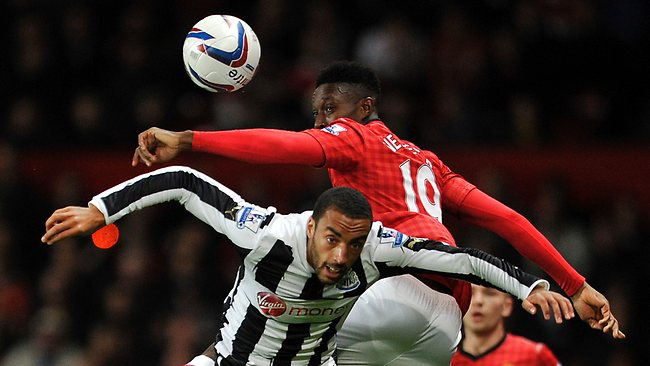 Manchester United's Danny Welbeck, top and Newcastle's United's James Perch, bottom contest a header during their English League Cup third round match at Old Trafford. Picture: Clint Hughes