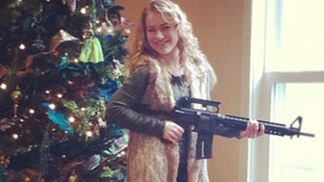 A woman poses with the powerful weapon she received for Christmas.