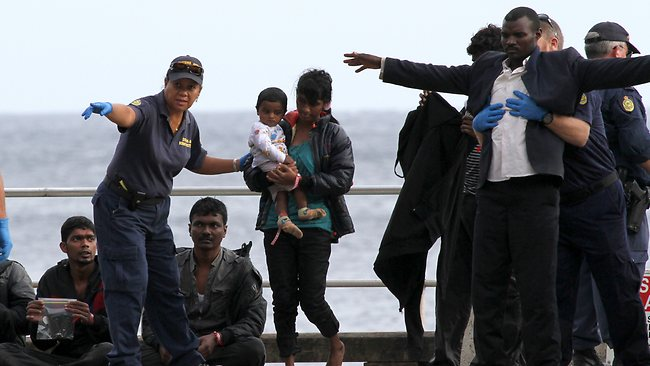 The latest crop of asylum seekers arriving by boat from HMAS Larrakia to Christmas Island.