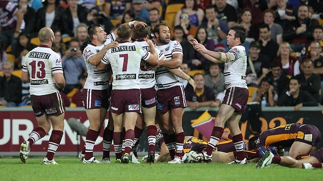 Manly celebrate after their last-minute win in the NRL round 10 game against the Brisbane Broncos at Suncorp Stadium. Picture Peter Wallis