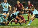 Sam Thaiday drops the ball as he goes over the tryline. pic Mark Evans