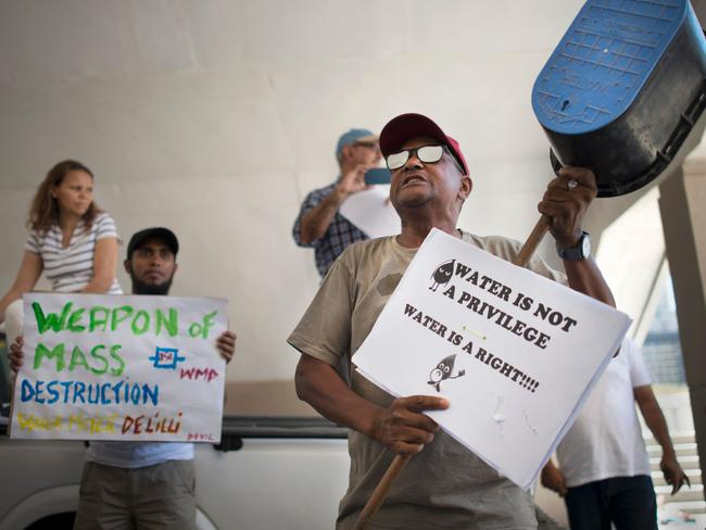 A man addresses hundreds of people taking part in a protest against the way the Cape Town city council has dealt with the water shortages. Picture: Rodger Bosch
