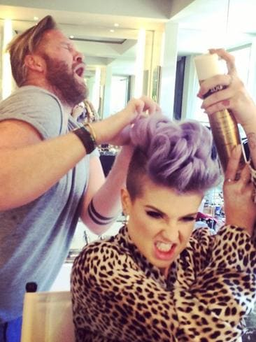 "US TV presenter Kelly Osbourne gets revenge on her stylist. "" Getting @itsryanrandall back for always spraying hairspray in my bloody mouth!"" Picture: Instagram"