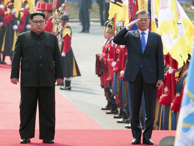 Mr Moon salutes as Kim stands during a welcome ceremony at the border village of Panmunjom. Picture: Korea Summit Press Pool/AP