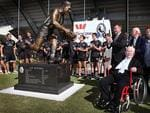 Lou with Eddie McGuire and Collingwood players at the unveiling of his statue outside Collingwood's Westpac Centre. Picture: Wayne Ludbey