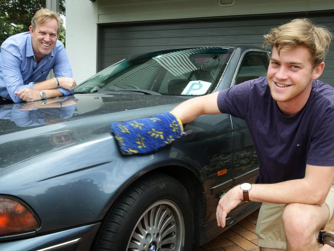 Alternative options ... Clark Montagu and son Parker, 18, with his first car. Picture: Liam Kidston.