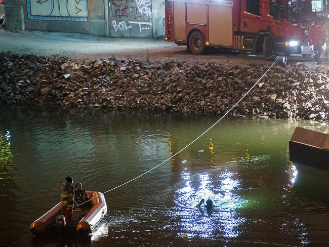Divers and rescue service personnel search for the victims of the deadly car crash in the canal Picture: AFP / TT News Agency / Johan Nilsson