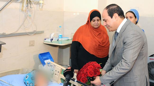 Controversy ... Egyptian President Abdel Fattah al-Sisi visits the hospital where the victim of a sexual assault in Tahrir Square.
