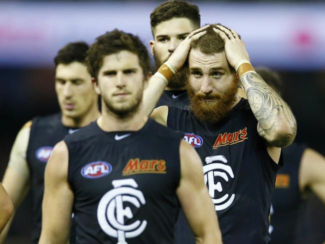 Disappointed Carlton players Marc Murphy and Zac Tuohy trudge off the field. Picture: Michael Klein