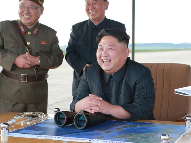 North Korean leader Kim Jong Un, attends what was said to be the test launch of an intermediate range Hwasong-12 missile at an undisclosed location. Picture: AP