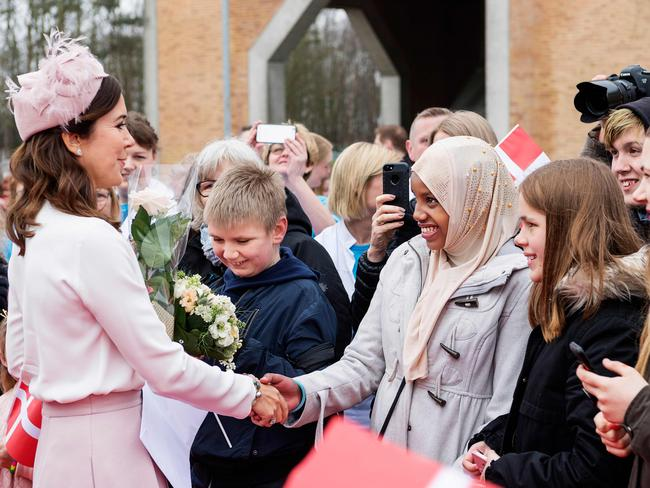 Danish Crown Princess Mary shakes hands with young wellwishers as she attends the opening of Slagelse Hospital. Picture: AFP