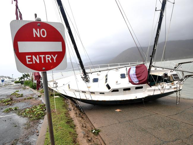 A boat is seen smashed against the bank at Shute Harbour, Airlie Beach. Picture: Dan Peled/AAP