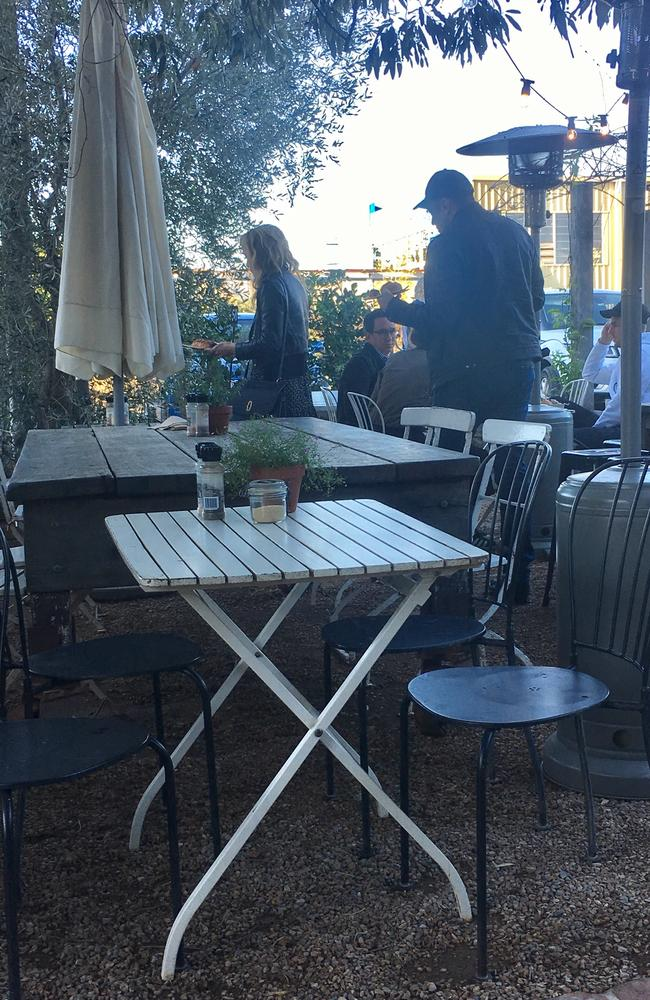Amber Heard and Elon Musk arrive at Paddock Bakery, Miami and look for a suitable table. Photo: Sally Coates