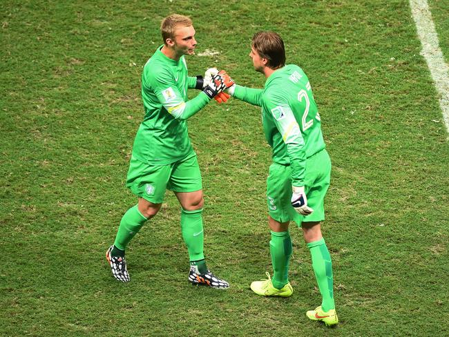 Tim Krul of the Netherlands shakes hands with Jasper Cillessen as he replaces the latter in goal for the penalty shootout.