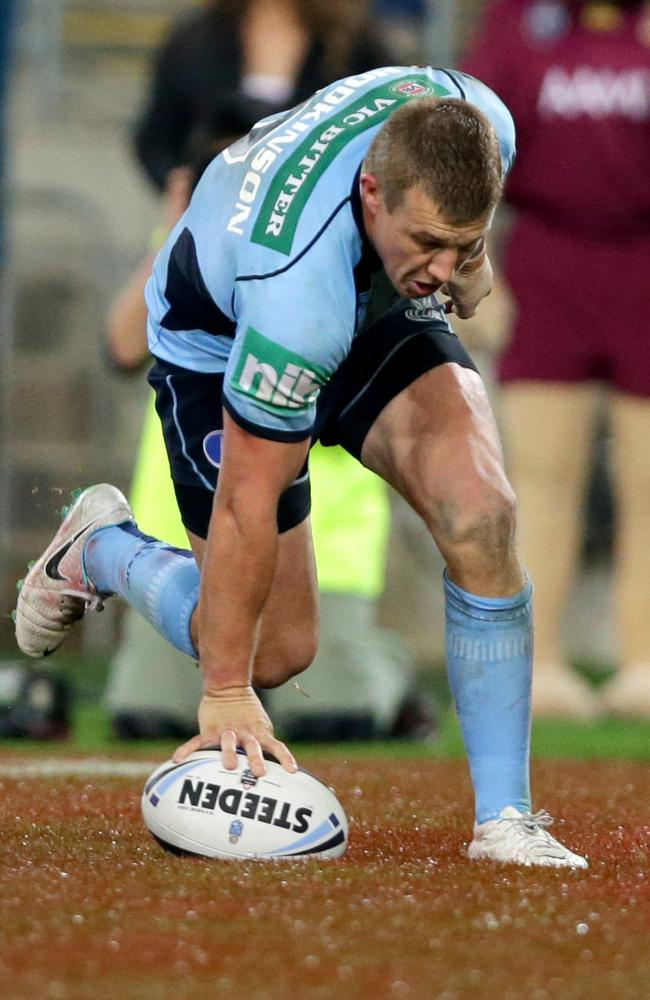 Trent Hodkinson scores a try during Game 2 of the 2014 State of Origin series.