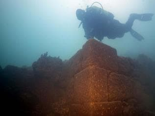 A diver is pictured over a corner of the ancient walls of a submerged fortress, found under Lake Van near Turkey's border with Iran. Picture: