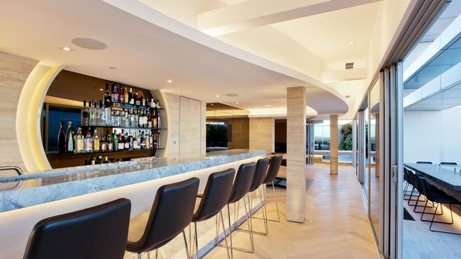 The upstairs bar is perfect for hosting parties with a view.
