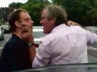 BBC television director Fergus Beeley grabs Simon Gale by the chin in this shocking road rage incident caught on camera