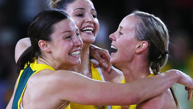 Made Robinson, Kimberley Ravaillion and Renae Hallinan celebrate after winning Commonwealth Games gold in Glasgow.
