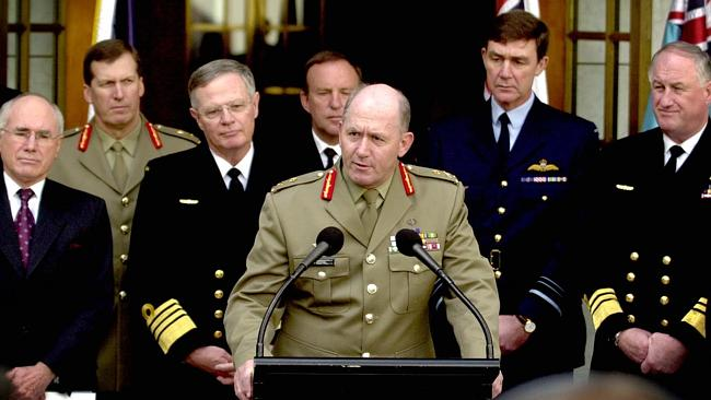 Howard's man ... Peter Cosgrove (centre) after being appointed Chief of the Defence Force with then-Prime Minister John Howard.