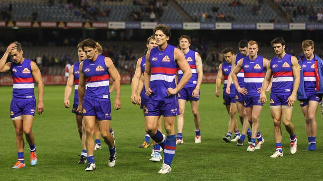 Bulldogs leaders Daniel Giansiracusa, Ryan Griffen and Will Minson lead the team off the field. Picture: Getty