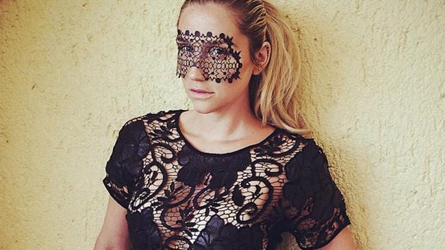 As well as posing seductively in masks, Singer Ke$ha wears a necklace made with placenta. Picture: Instagram