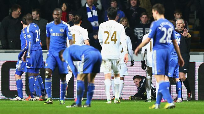 A BALLBOY on the ground after being kicked by Eden Hazard of Chelsea at Liberty Stadium . Picture: Michael Steele