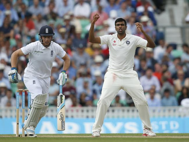 India's Ravichandran Ashwin, right, reacts as England take a single run off his bowling during the second day of the fifth test cricket match at Oval cricket ground in London. Picture: Alastair Grant