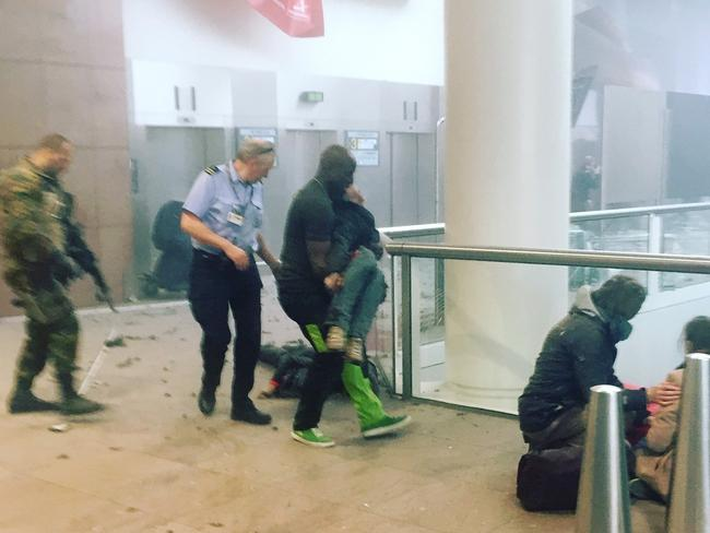 This photo provided by Georgian Public Broadcaster and photographed by Ketevan Kardava, shows the scene in Brussels Airport after explosions were heard.
