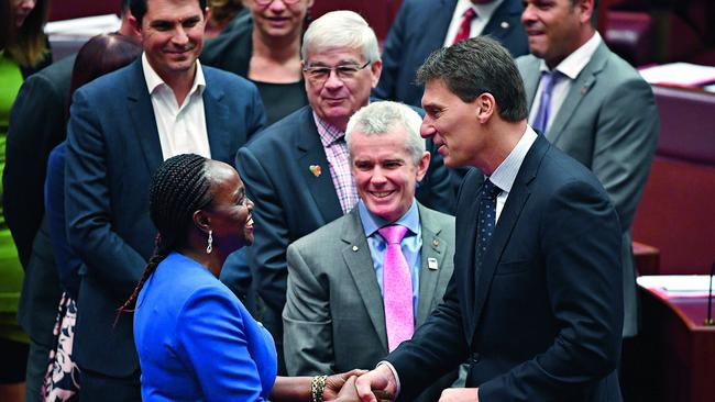 Cory Bernardi greets Gichuhi after her swearing-in; she chose not to join his party. Pic: AAP