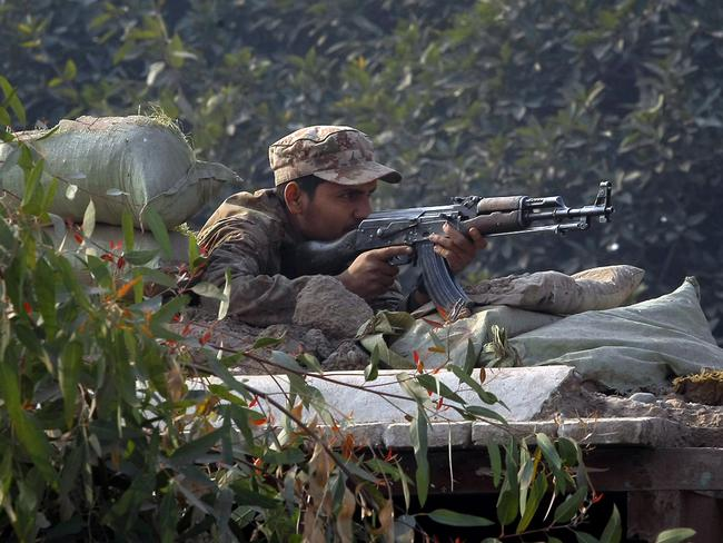 At the ready ... Pakistani soldiers take up position. Picture: AP/Mohammad Sajjad