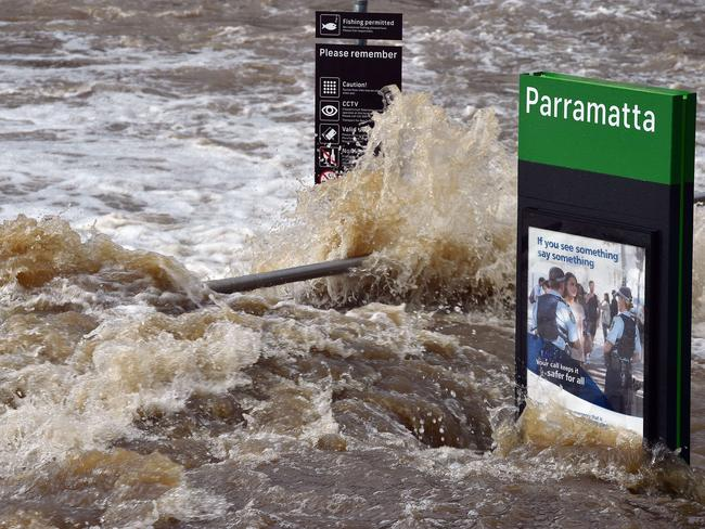 Flood waters enter the Parramatta ferry wharf in Sydney Pic: Saeed Khan
