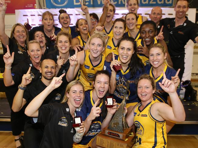 Winners are grinners. The defending champion, the Sydney Uni Flames.