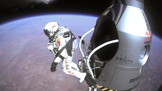 Austrian daredevil Felix Baumgartner became the first man to break the sound barrier in a record-shattering free-fall jump from the edge of space. The 43-year-old leapt from a capsule more than 38km above the Earth wearing a pressurised suit, and plunged through the stratosphere and free-fall for more than four minutes. Baumgartner reached a speed of 1136km/h before opening his red and white parachute and floating down to the New Mexico desert. Picture: AFP/www.redbullcontentpool.com