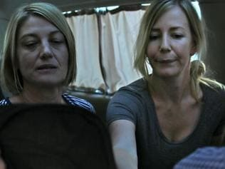 UPLOADED IMAGE - Australian TV journalist Tara Brown, left, and Sally Faulkner, right, the mother of the two Australian children, sit in a minivan after they released from a Lebanese jail with the three members of Channel 9 Australian TV crew, in Baabda east of Beirut, Lebanon, Wednesday April 20, 2016. An Australian mother and TV crew caught up in a high-profile child custody battle and detained in Beirut amid a botched attempt to take the woman's two children from their Lebanese father have been released on bail. (AP Photo/Hussein Malla)