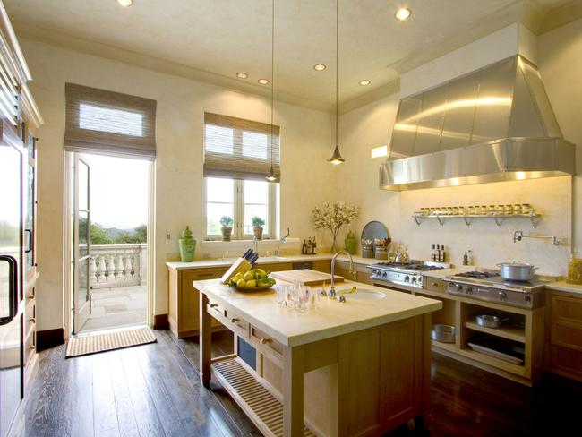 An open plan kitchen leads out to a balcony.
