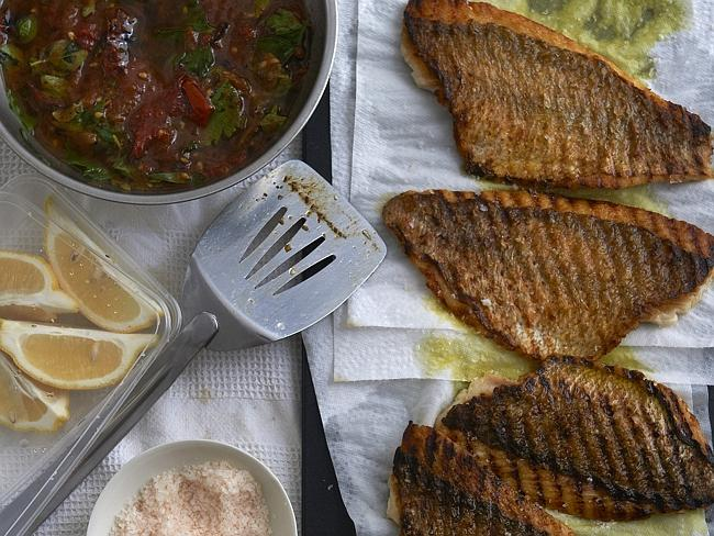 Neil Perry likes to fire up the BBQ ... here is his Snapper fillet with tomato sauce. Picture: Neil Perry