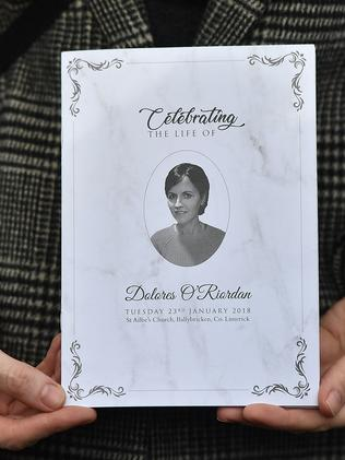 A mourner holds up an order of service ahead of Dolores O'Riordan's funeral. Picture: Charles McQuillan/Getty Images