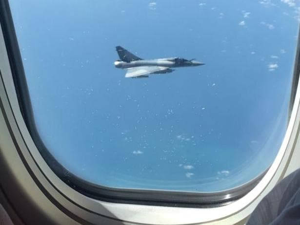 Passenger Emily Hatfield snapped this photo of a fighter jet shadowing the flight