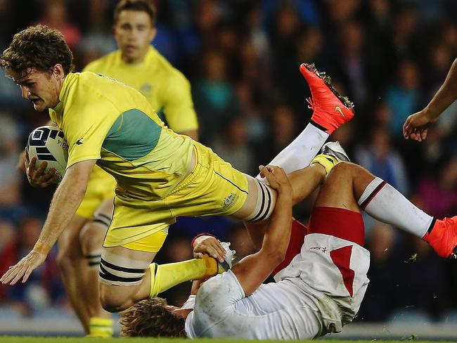 Con Foley of Australia charges forward during the Rugby Sevens match against England.