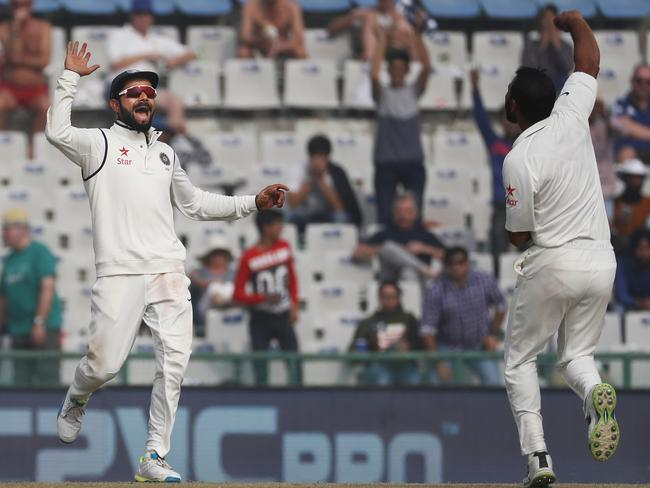 Virat Kohli, left, and Mohammed Shami are jubilant after the dismissal of Chris Woakes.